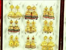 big jhumka gold earrings traditional gold plated big jhumka earrings collection navya