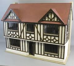 a scratch built wooden three storey doll s house of mock tudor