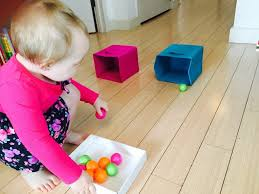 fun things for 67 years old rolling ping pong balls into boxes toddler activities activities