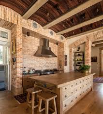 brick pattern tile kitchen transitional with arched doorways