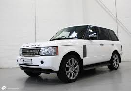 wrapped range rover sport range rover vogue in 3m gloss white personal vehicle wrap project