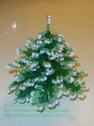 How To Make Christmas Ornaments Out Of Beads - christmas tree decorated with balls and garland out of beads and