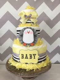 penguin baby shower diaper cake in pale yellow grey and black