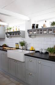 exquisite grey tall kitchen cabinet white subway tile backsplash