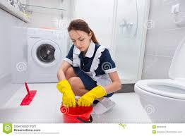 housekeeper cleaning a bathroom floor stock photo image 69401503