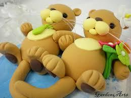 otter cake topper customise wedding cake topper sea otter hold
