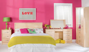 pink wall theme and purple wooden bedroom shelves connected by