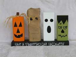 wood block halloween decoration with pumpkin mummy ghost and