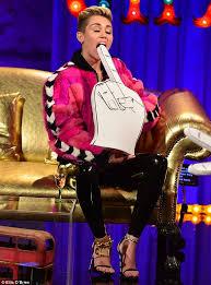 Miley Cyrus Twerk Meme - miley cyrus gets suggestive with a foam finger before twerking on