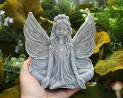fairy statue meditation in the enchanted garden