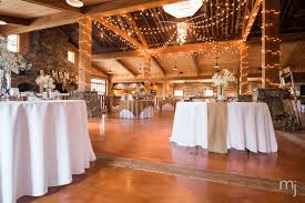 informal reception setting rustic barn wedding with decorative