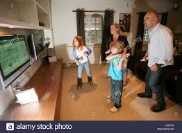 family play wii home video game console together in their sitting