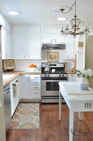 what hardware for white kitchen cabinets white painted kitchen cabinets with brass hardware