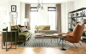 room and board leather sofa check out this light space with tan leather chairs and green room
