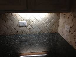 tumbled travertine herringbone backsplash never grout this just