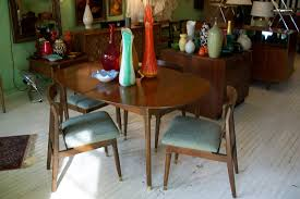 an orange moon apartment sized mid century modern dining room set