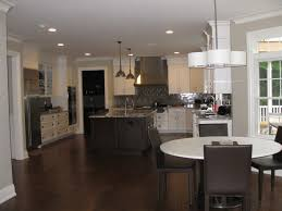 20 impressive kitchen flooring options for your kitchen floors view in gallery black wooden kitchen flooring ideas with drum shape chandeliers lighting on kitchen island