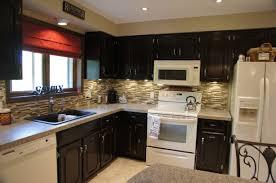gel tile backsplash travertine countertops staining kitchen cabinets darker lighting