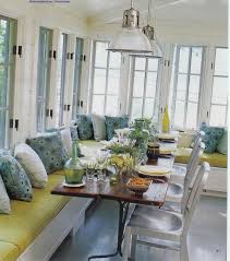 dining room green dining banquette with polkadot cushions and