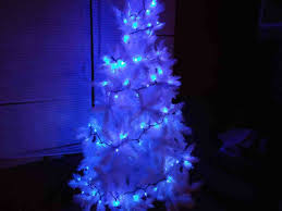 white tree with blue lights cheminee website