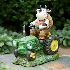cow on tractors outdoor living outdoor decor lawn ornaments