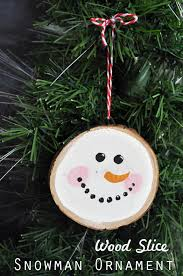 easy ornament craft using a wood slice snowman