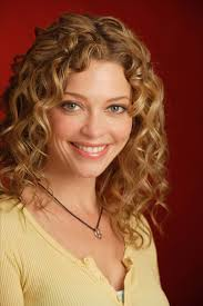 naturally curly medium length hairstyles prom curly hairstyles for medium length hair with flower