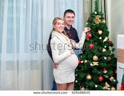 happy pregnant woman sitting on floor stock photo 529486699
