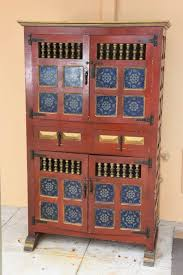 spanish hand painted antique kitchen cupboard with blue tiles at