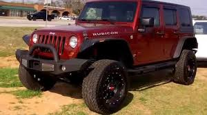 lifted jeep red 2009 lifted jeep wrangler unlimited at ginn chrysler jeep dodge