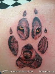 wolf in paw print artists org