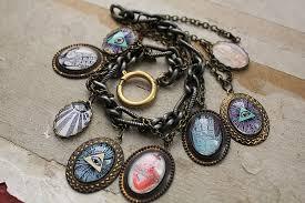 themed charm bracelet religious mystical occult themed charm bracelet by asunder on