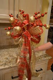 red and gold ribbon tree topper christmas winter pinterest