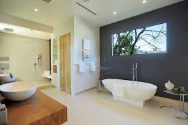 modern bathroom with freestanding tub and dark grey accent wall