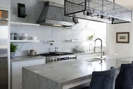 industrial style kitchen with iron cage pendant and waterfall