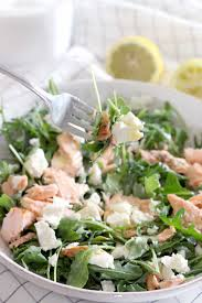 salmon goat cheese and arugula salad with creamy lemon garlic