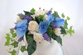 blue flowers for wedding large wedding cake arrangement in ivory lilac and blue flowers