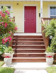 red door with yellow house google search exterior color