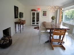 white washed wood flooring dining room contemporary with armoire