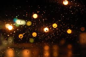 pictures of night lights night lights in the rainy city through the window