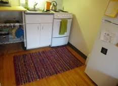 Galley Kitchen Rugs Beautiful Rug Set Between Modern Galley Kitchen Interior