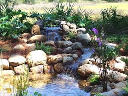 pond with waterfall and stream island garden features