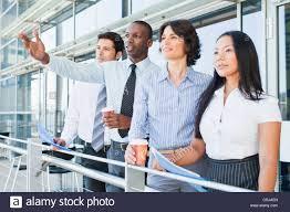 business people on indoor balcony stock photo royalty free image