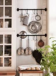 Hanging Pot Rack In Cabinet by Hanging Bar Pot Rack Foter