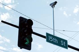 do traffic lights have sensors what are those little things on top of street lights at an