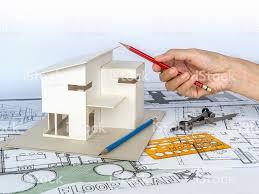 housing blueprints architect working with house model blueprints housing development