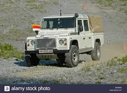 white land rover defender land rover defender 130 td5 crew cab white stock photo royalty