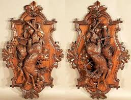 pair of large wall plaques decorated with carved stag