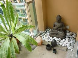 bring serenity into a room by combining buddha statues with a my little buddha garden on the balcony of my apartment
