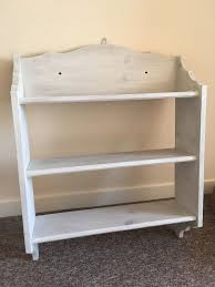 attractive whitewashed shelving unit three tiers wall mountable